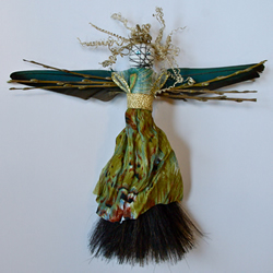 Guardian Relic with parrot feathers